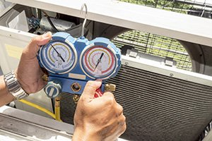 Single man hold manometer, Measure equipment of Air Conditioner on his hand under sunlight in the balcony