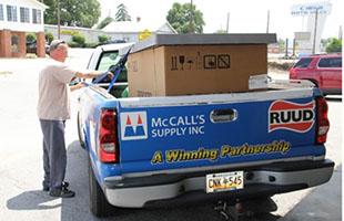 man standing beside a mccalls work truck